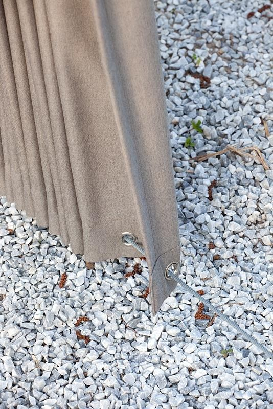 a great idea for outdoor curtains to keep them fixed... Might try a retractable clothes line for the bottom so you don't trip... Love this idea! - naturewalkz