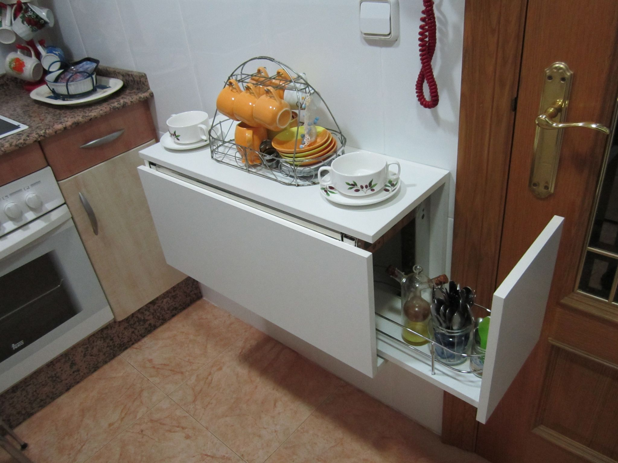 Mesa abatible en m dulo de cocina joster muebles for Mesa abatible cocina