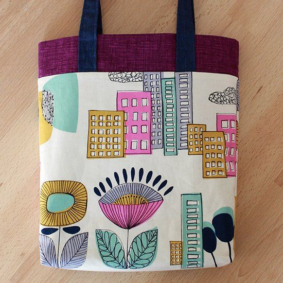 Show off your stash fabrics! Sew three fabrics, in ten steps, for one lined tote bag with zero bottom seam using this clever tutorial