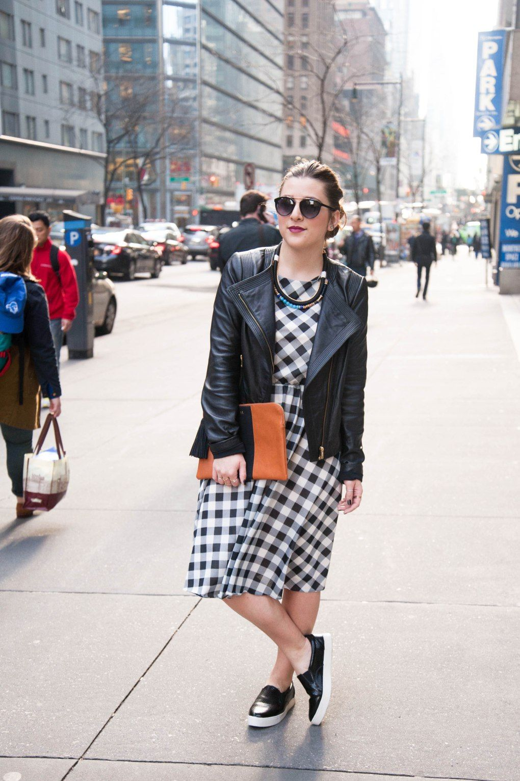 {Checkered Spring Dress | Simply Audree Kate} Black and white gingham print dress styled with a leather jacket and black slip on shoes
