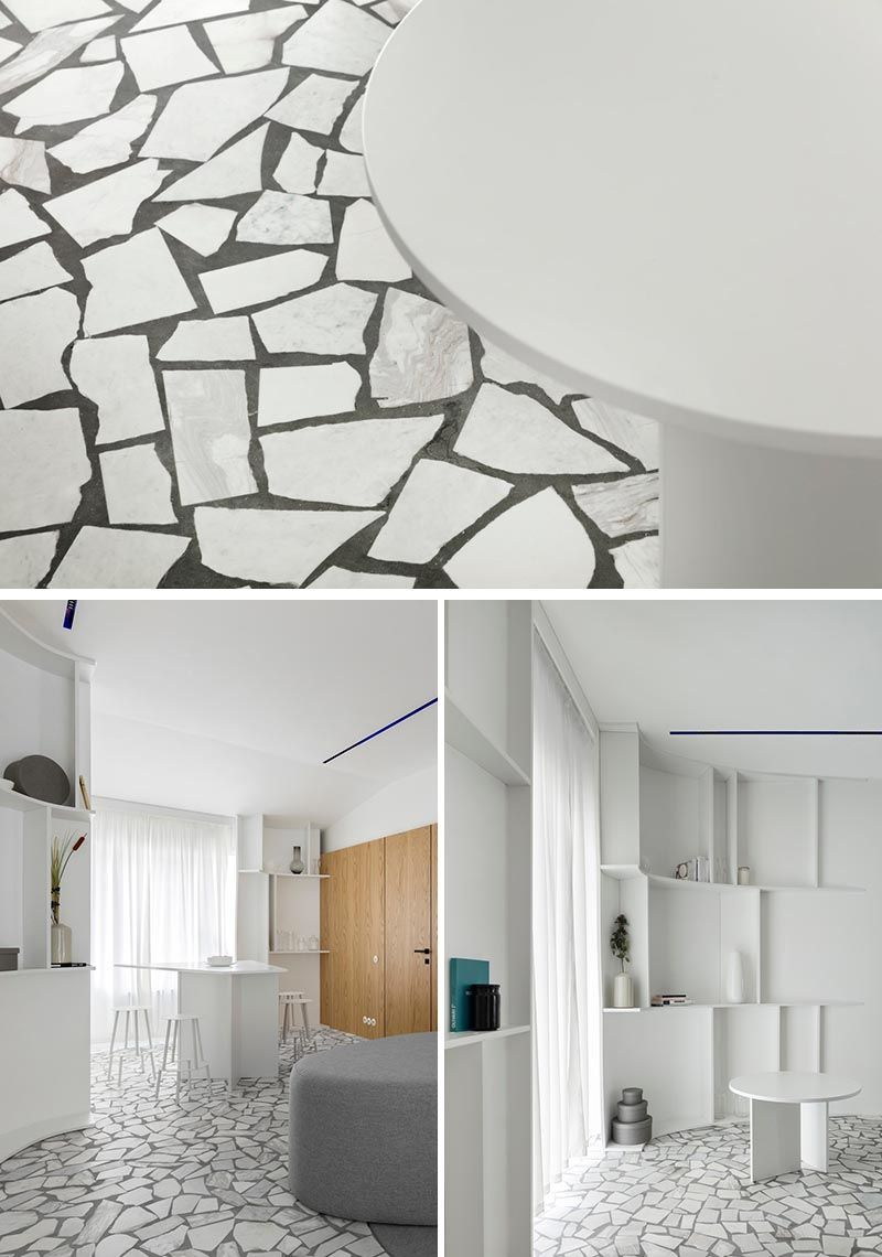 A Mosaic Of Broken Marble Gives This Flooring A Unique Design In 2020 White Marble Mosaic Flooring Design