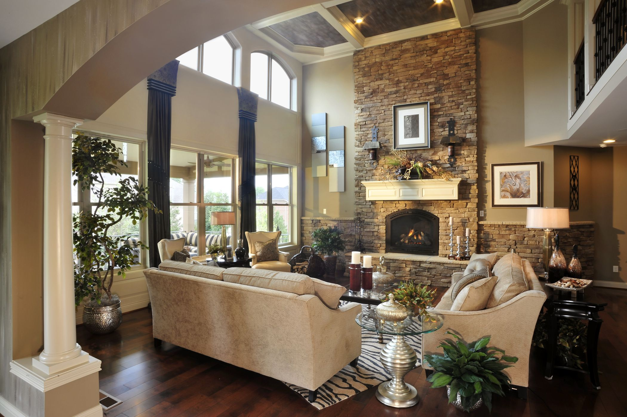 Beautiful living space with story stone fireplace and splendid