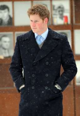 Prince Harry stands in the snow as he visits the Bernauer Strasse Wall Memorial in Berlin, Germany. - WENN