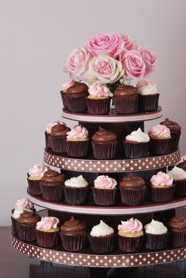 cupcake wedding cake: i like the more streamlined towers. red velvet & cream cheese topping, here i come!