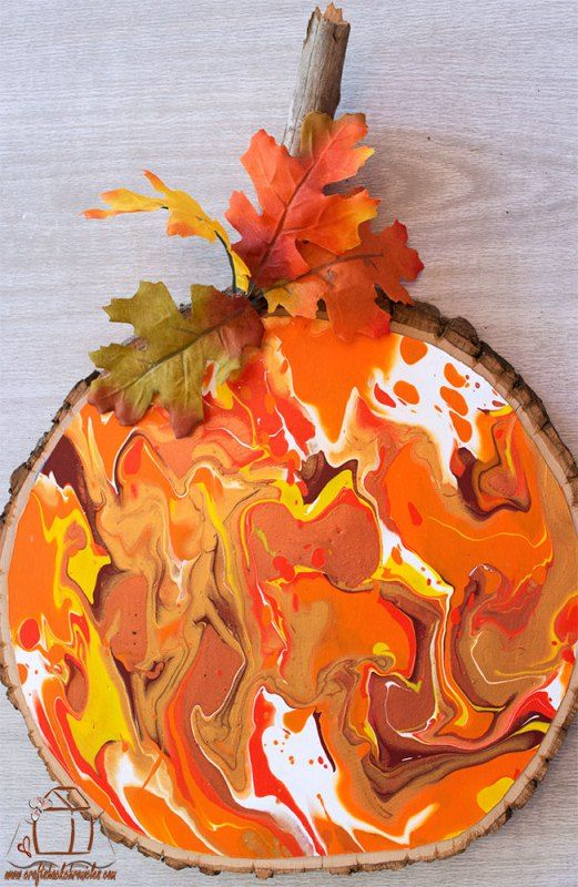 Easy Marbled Wood Slice Pumpkin Paint Pouring Tutorial is part of Fall wood crafts, Wood slice crafts, Wood slice art, Painted pumpkins, Wood projects, Wood slices - You can create your own marbled paint pouring effect without expensive pouring mediums  Use supplies you likely already have for a gorgeous marbled look!