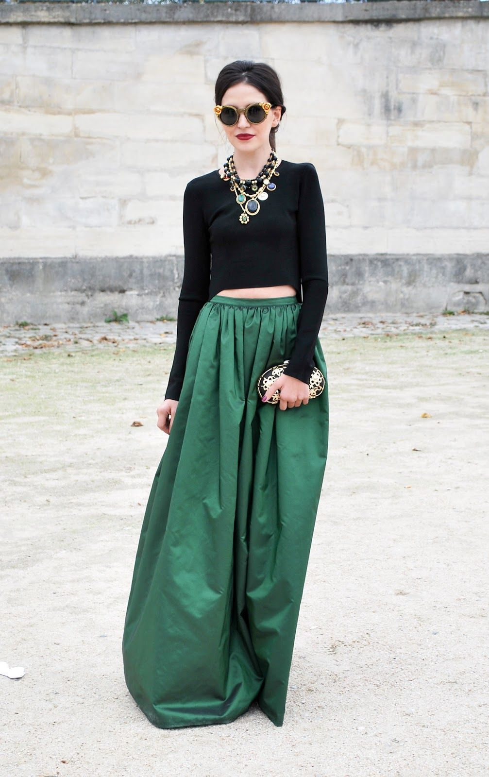 emerald green skirt, black top, jewels and shades Twirling Clare ...