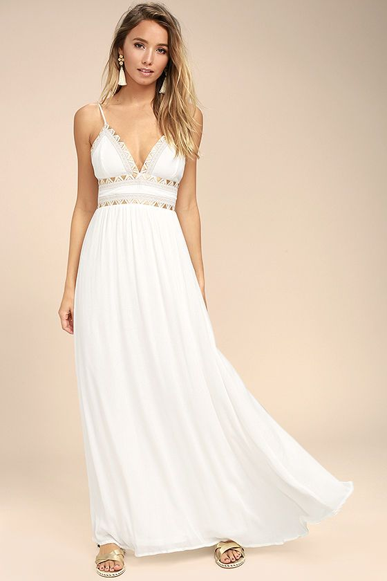 b9428ccc360 Transform into an ancient goddess in the Giza White Embroidered Maxi Dress!  Beige Boho embroidery decorates a backless