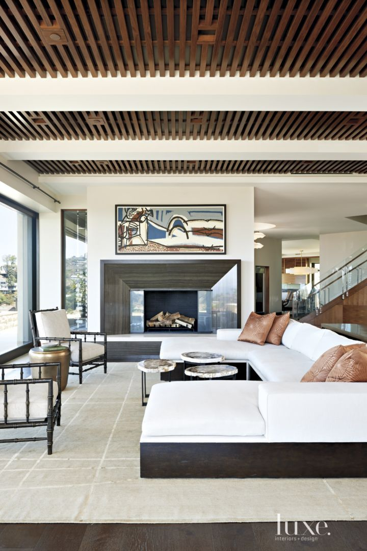 A Modern Hillside Laguna Beach Dwelling With A Resort Style Feel Luxe Interiors Design Modern House Design Fireplace Design Modern Interior Design