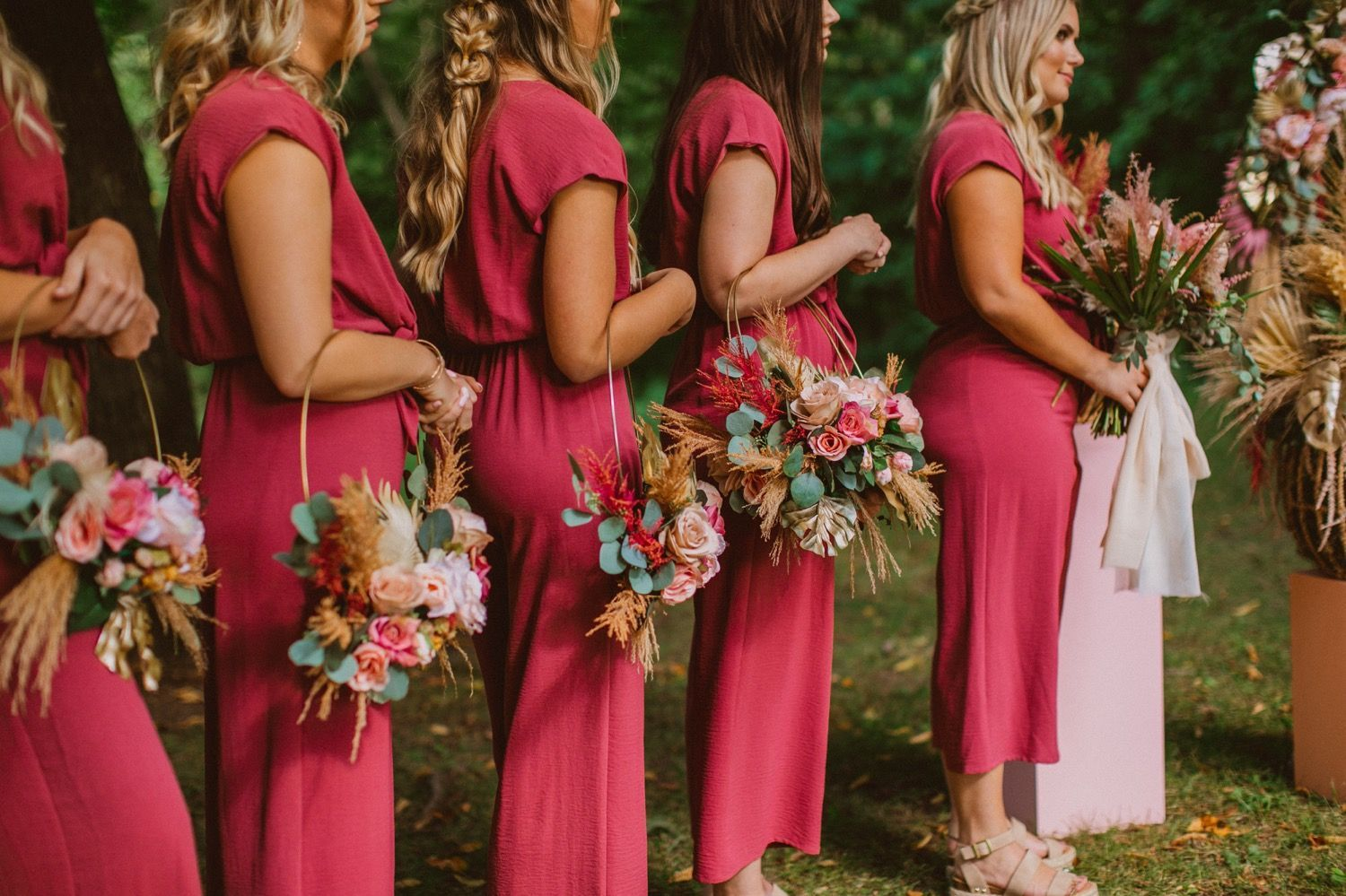 Literally the prettiest bride and her bridesmaids in Cedar Rapids, Iowa with pink bridesmaids JUMPSUITS and the most original wooden pink baskets holding their bouquets for their bouquets rings! Seriously to die for and the best pop of color for the most green forrest wedding! Best styled bridal party everrrrr! | Photo but: Olivia Markle Photography #bridesmaides #cedarrapidswedding #elopement #wedding #bridalpartystyle #pink #bridesmaids #bridesmaidjumpsuits Literally the prettiest bride and he #bridesmaidjumpsuits
