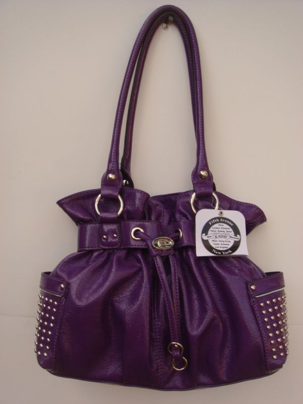 b5de11f5cb08 I love Kathy Van Zeeland purses. Also love the color purple. This purse is  perfect. (would like it a little more if the side pockets didn t have those  ...