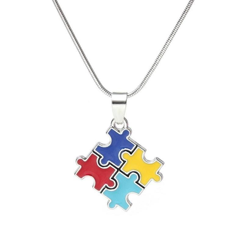 """This puzzle themed pendant is a great way of showing support for the Autistic community. The pendant is on an adjustable snake chain. Adjustable to 16"""" - 18"""". In the image, the pendent is shown at the 16"""" length."""