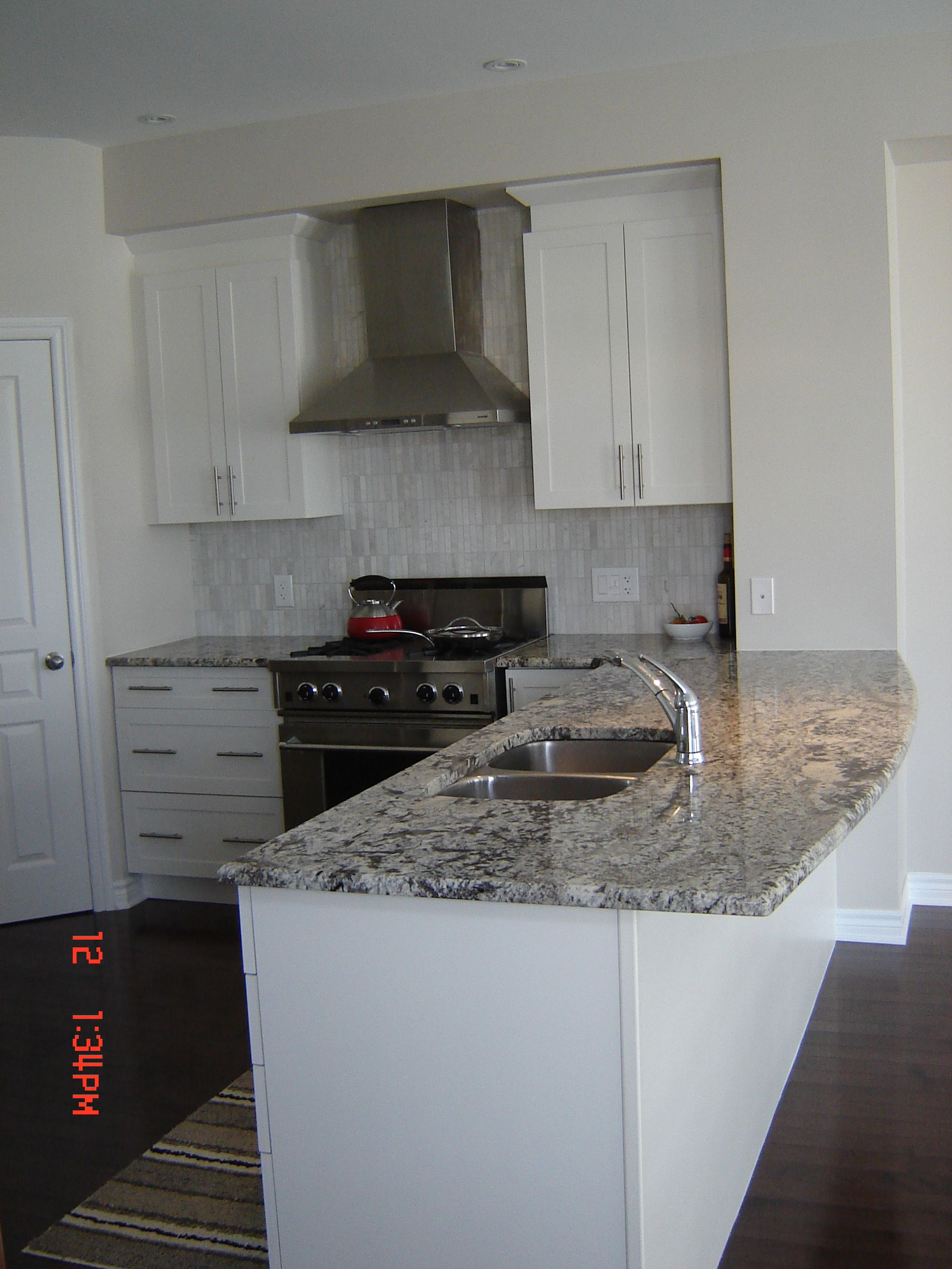 Bianco antico granite countertops white cabinets for Pictures of white kitchen cabinets with granite countertops