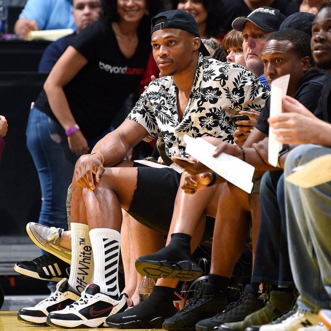 d37b9a70b4c  RussellWestbrook at the  LASparks game courtside wearing Nike  Monarchs  sneakers  Offwhite socks and floral print shirt.  morethanstats