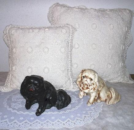 old plaster peke doggies