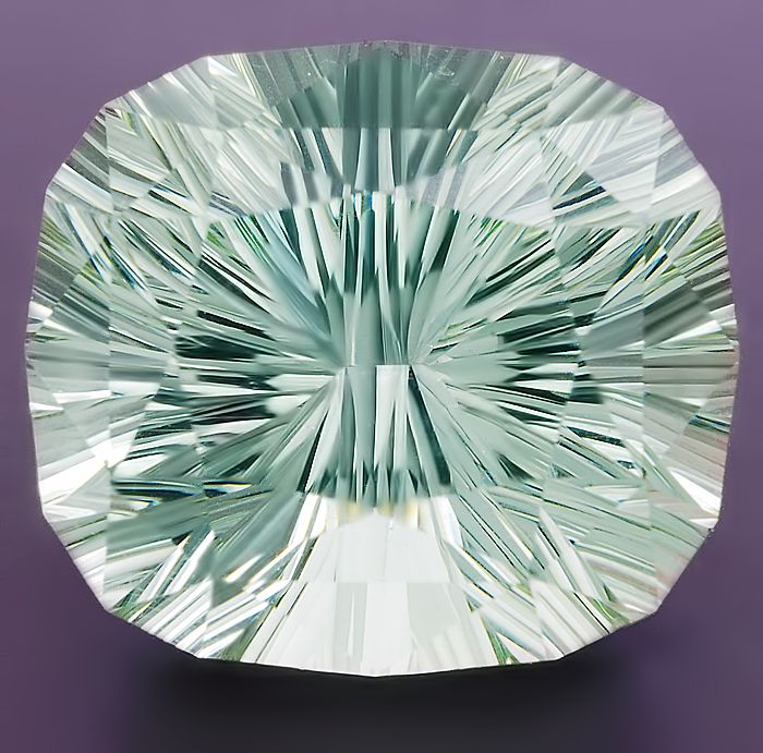 Untreated very light green Aquamarine cushion concave cut weighing 6.50 cts, from Madagascar
