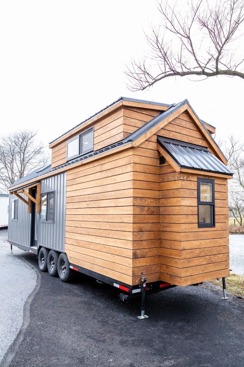 32 foot Farmhouse tiny house with a main floor bedroom for