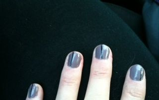 Steel Grey nail polish with black stripes (using Sally Hansen nail art pen). Poor lighting + no flash iphone = pasty skin :-)