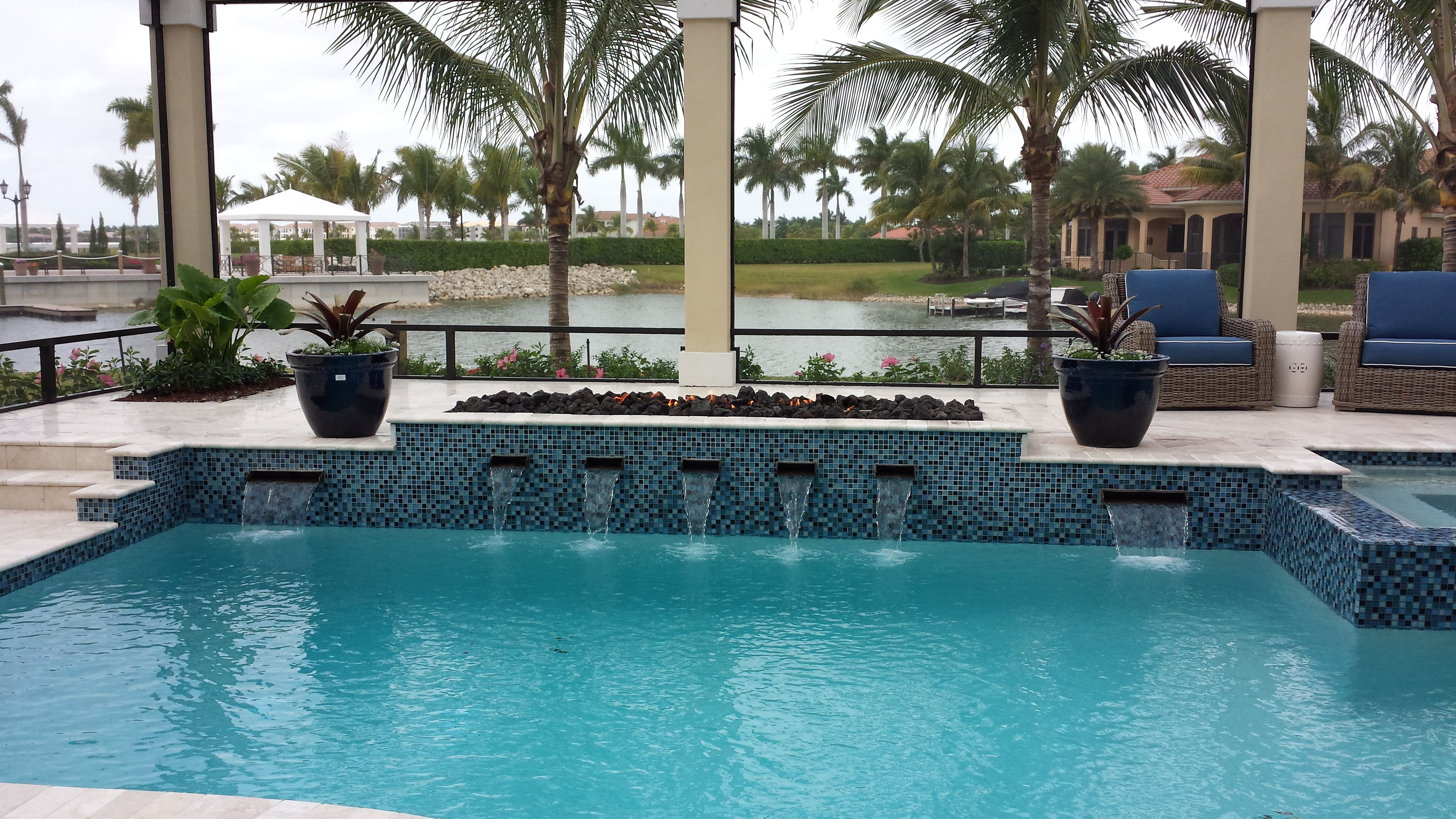 linear fire pit next to pool naples fireplace outdoor fireplaces