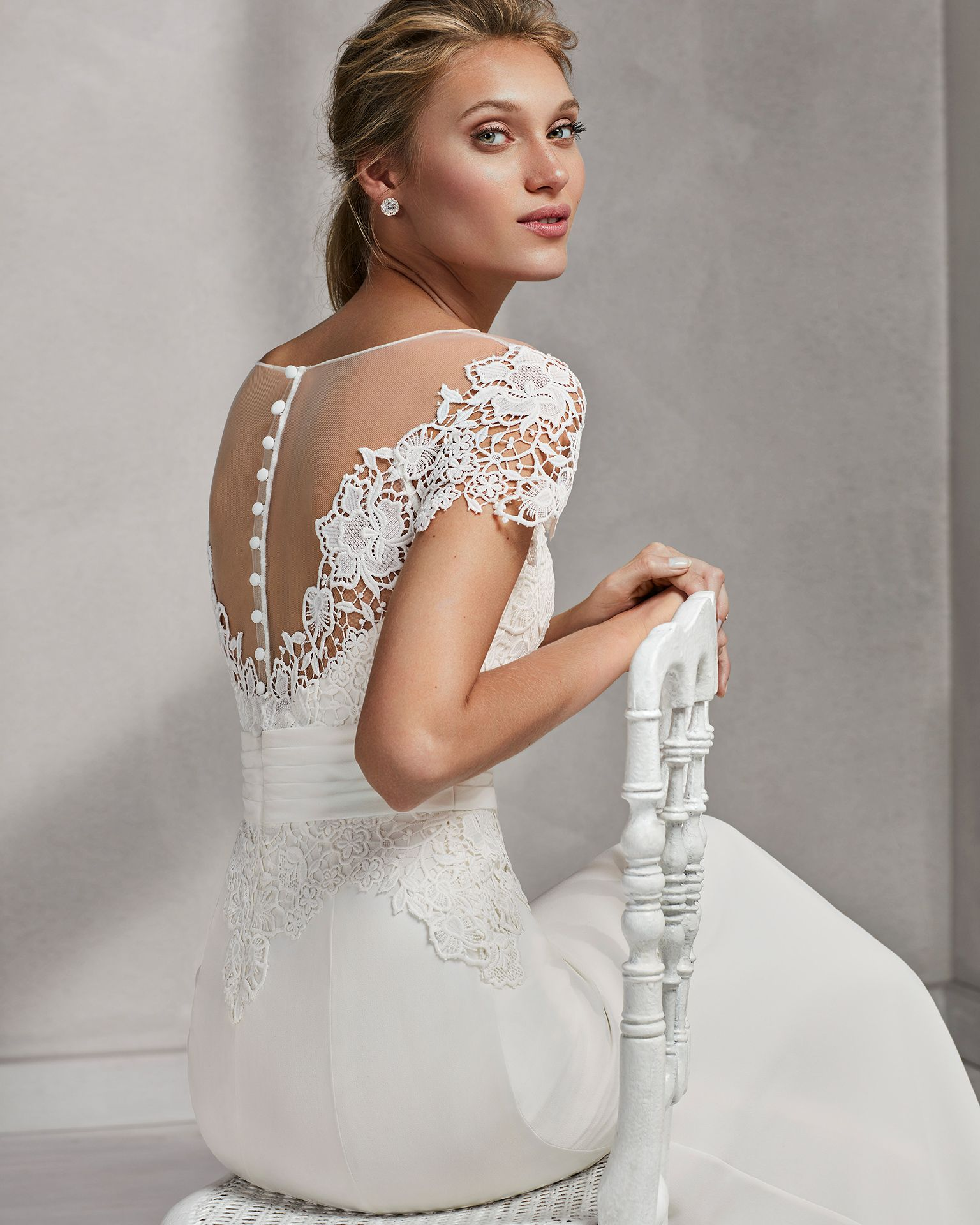 Mermaidstyle crepe georgette and guipure lace wedding dress with