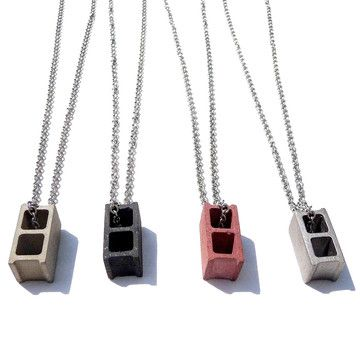 Fabcom Origami And Industrial Jewelry Necklaces modeled after