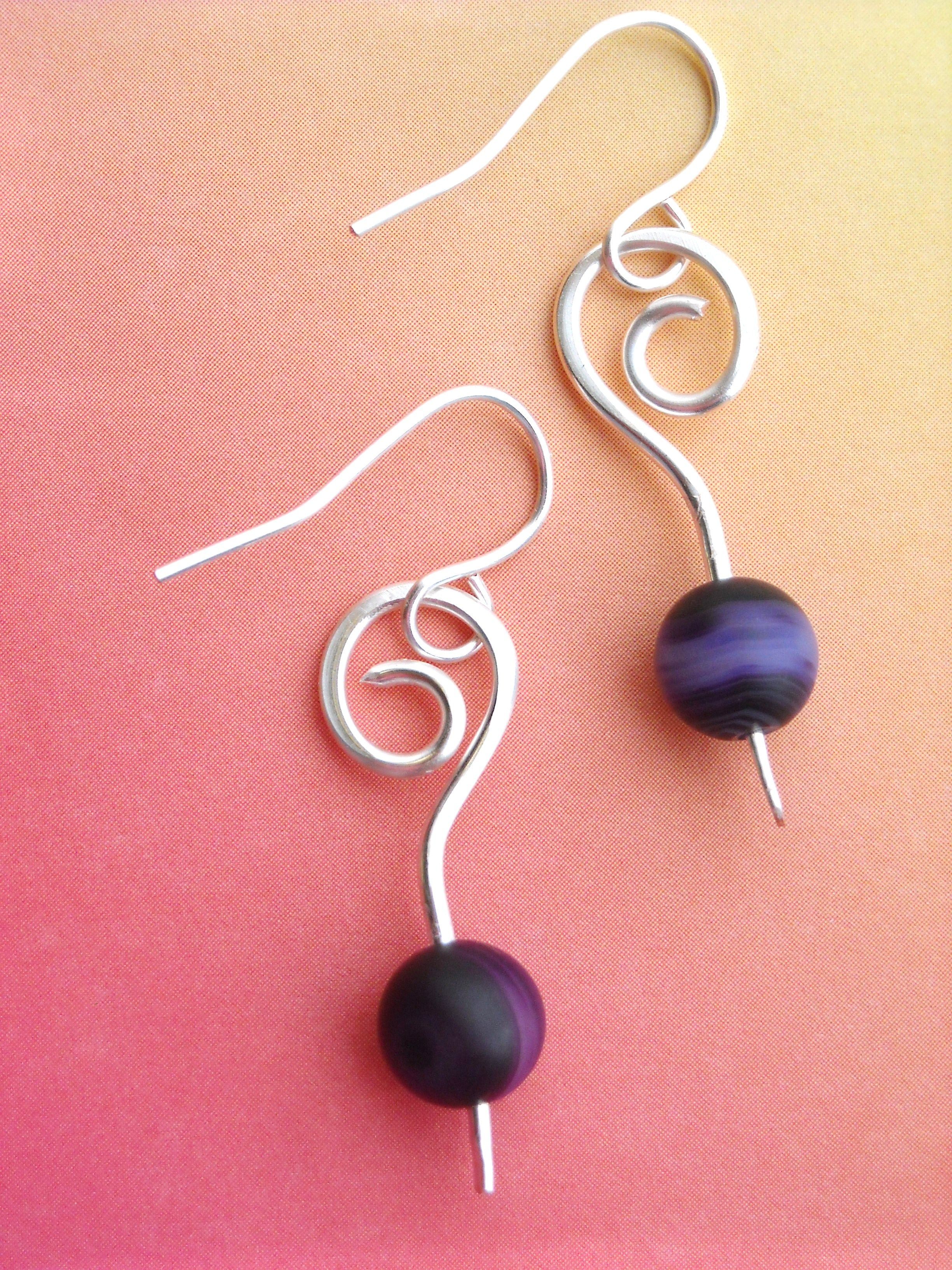 Silver plated wire with just one deep purple glass bead