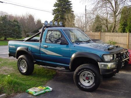 Regular cab with roll bar and lights truck roll bar styles pinterest toyota for Interior roll cage for toyota pickup