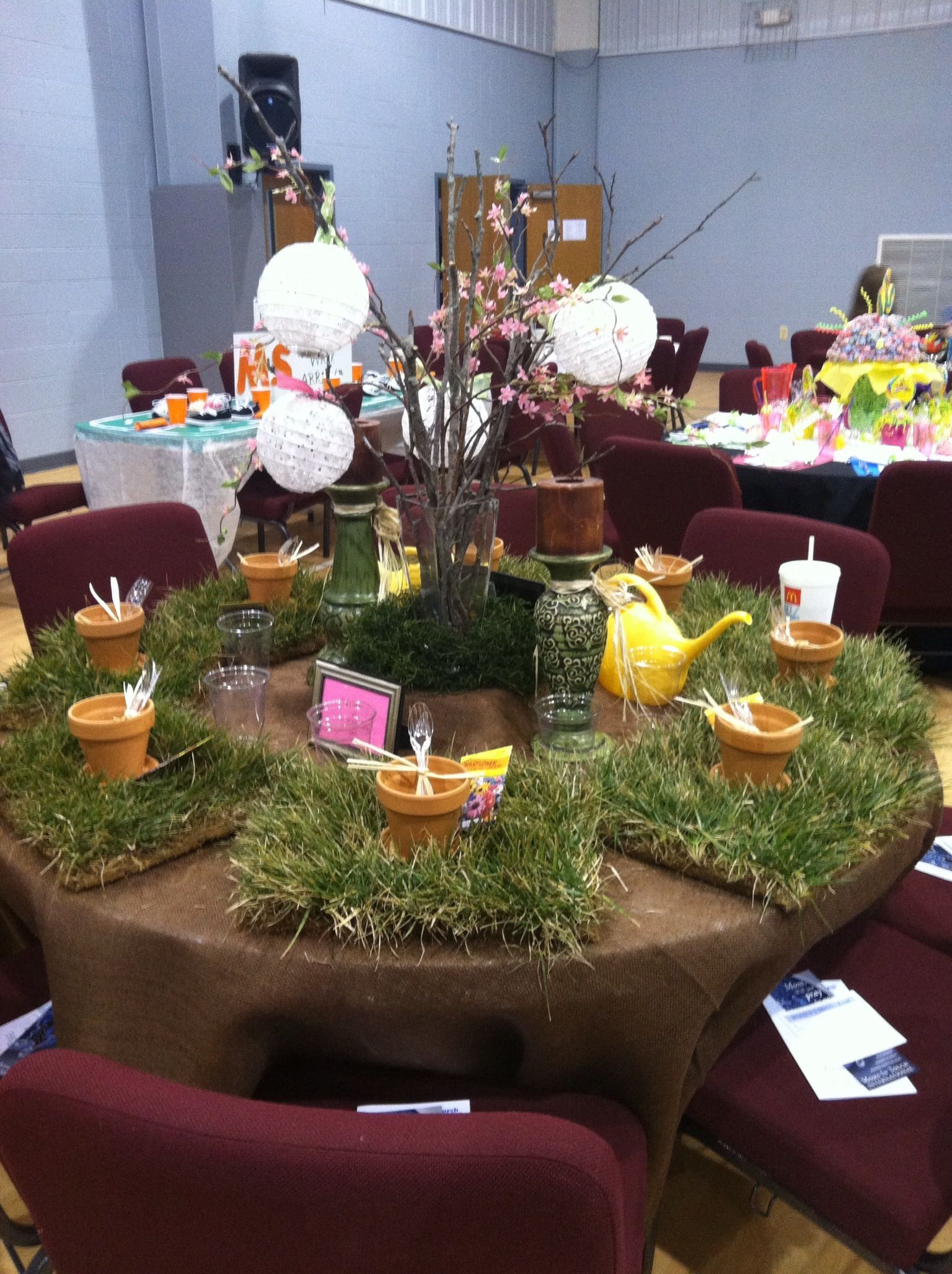 Garden/Outdoor themed table decorations using real sod grass as