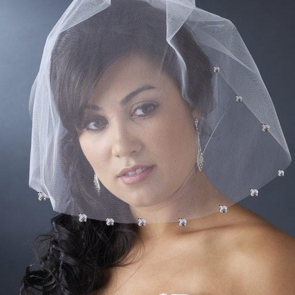 with sparkling crystals attached to a comb. A hair piece with a face veil