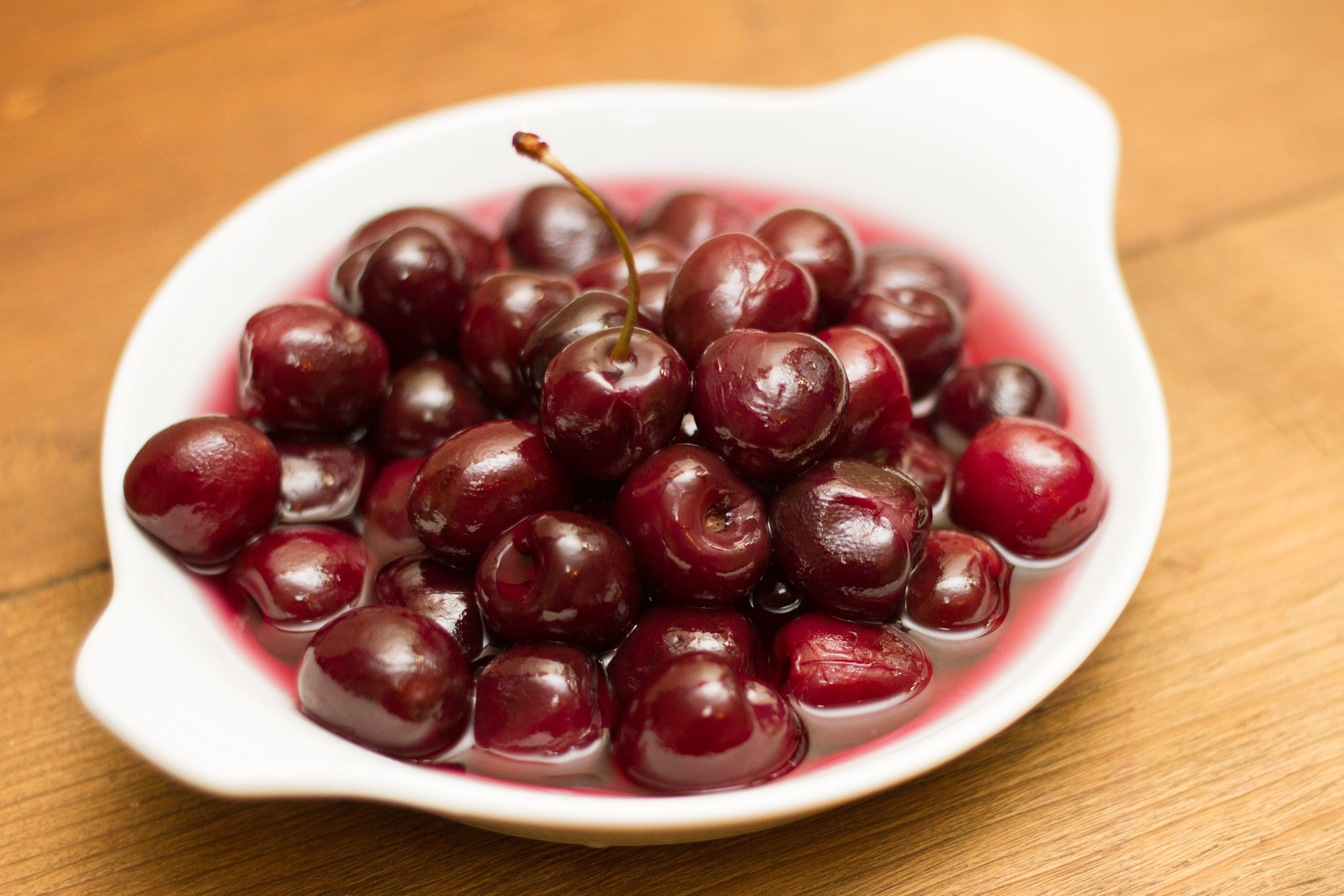Have you heard of glazed cherries and really want to try them? If you don't want to go out and buy it, make it yourself! Read this to find out how. Gather your items. You will need a pot, white sugar, a small pot.