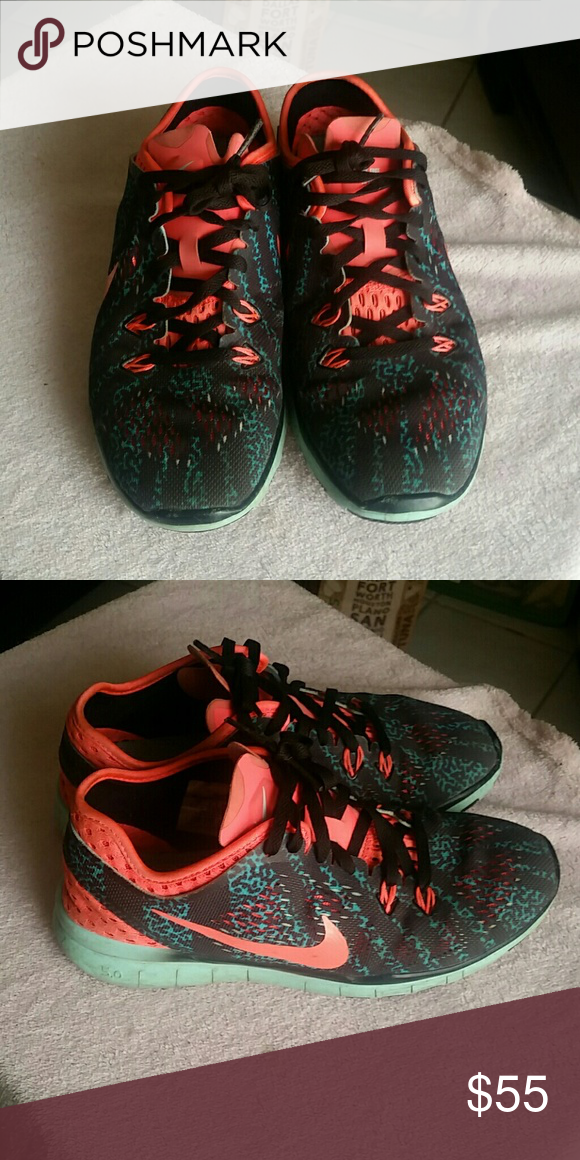 NIKE FREE TR FIT 5 Nikes used but still in great condition, light weight,  colors are like a coral pink with mint green and black Nike Shoes Sneakers