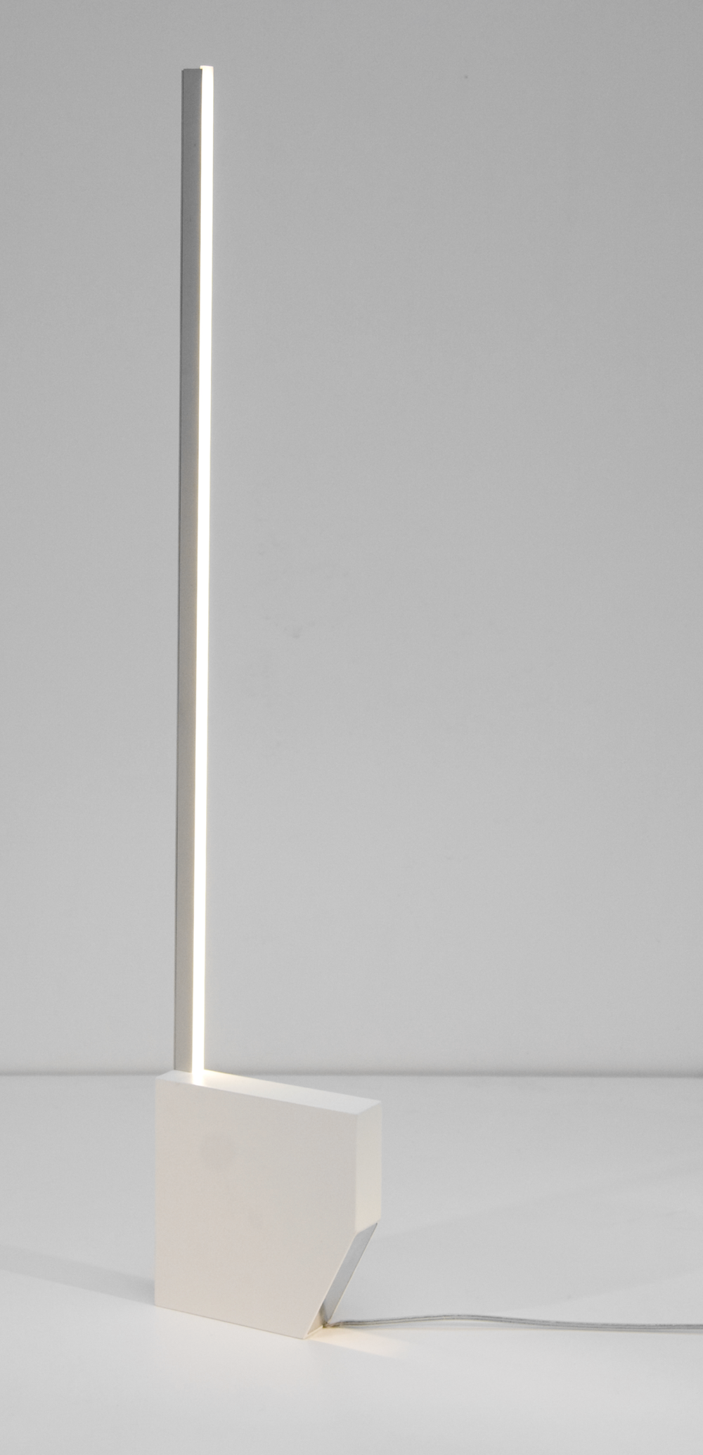 The Tumble Lamp or Tuimelled is another remarkable table and floor lamp design by renowned Dutch industrial designer Aldo van den Nieuwelaar. Originally designed in 1968 and re-produced by Dutch lighting brand Boops, in his honour, the tumble lamp is comprised of powder coated aluminium, an LED warm white lamp, featuring dimmer control, and is available in black and white.
