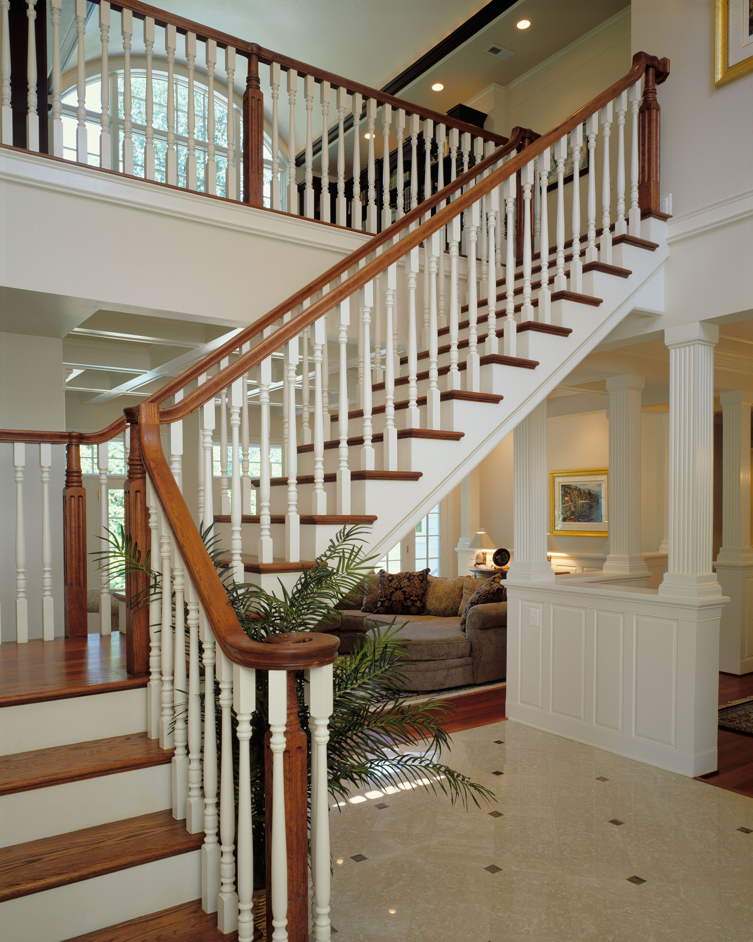 Natural wood stair, white painted risers and spindles with natural stained hand  rail, landing