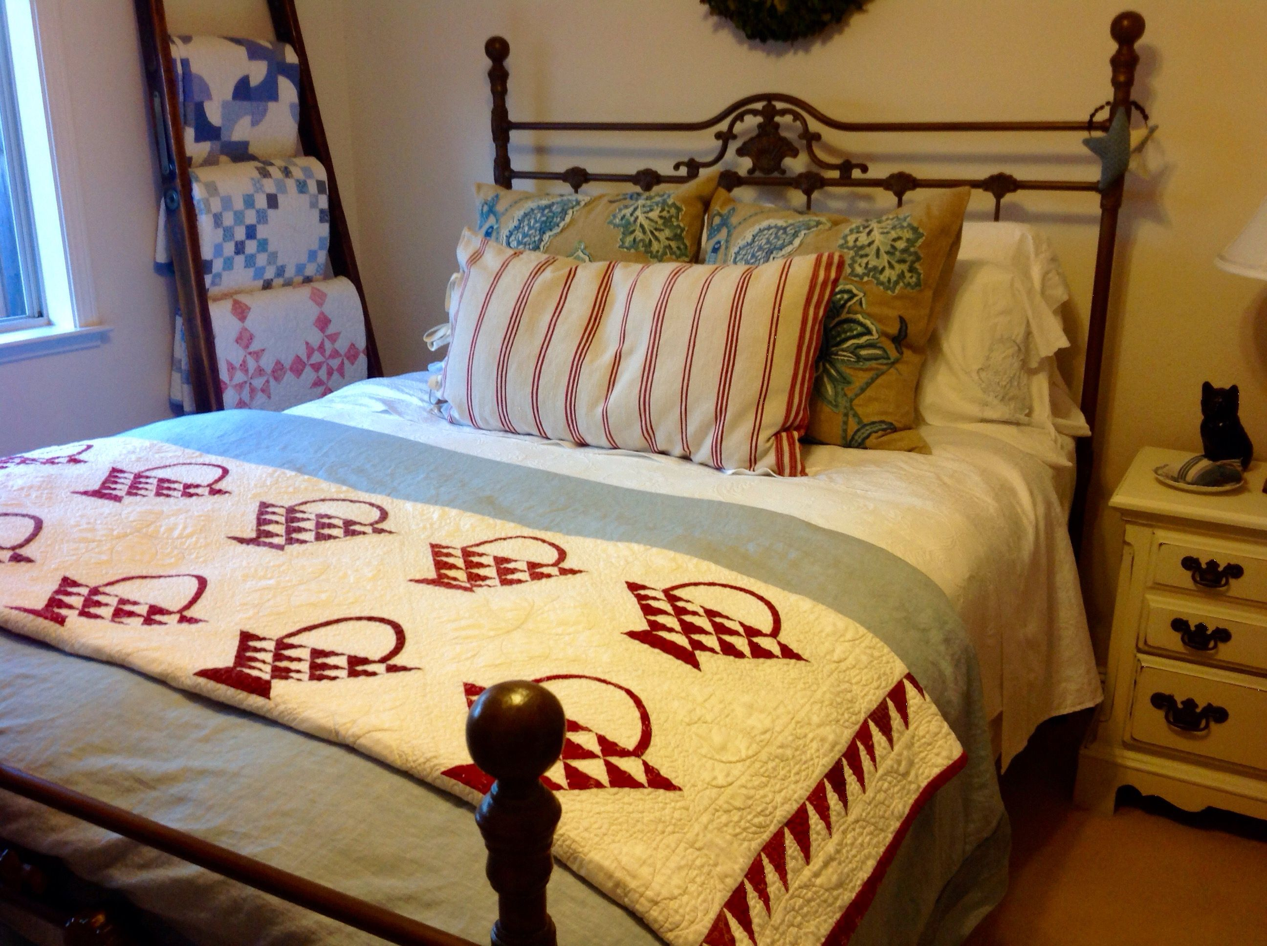 The guest bed.  Love the quilts.