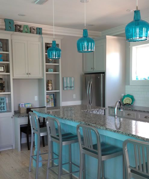 Beachy blue kitchen. Blue kitchen island and blue glass ...