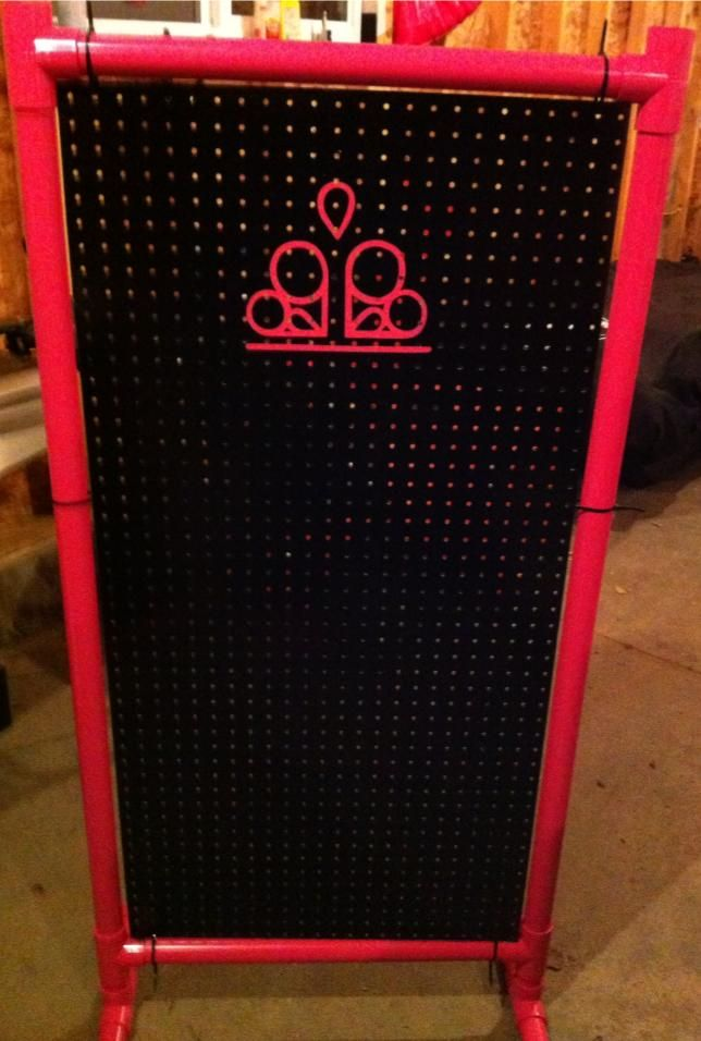 Peg board and PVC pipe display. No Directions attached,