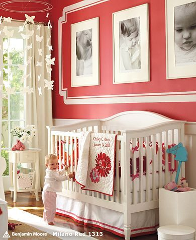 red baby room. framed wall. mobile.