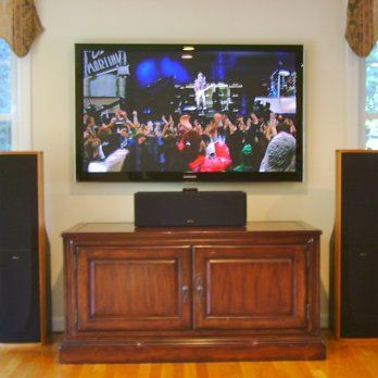 tv mounted on wall with tower speakers and center speaker placed on cabinet south shore audio. Black Bedroom Furniture Sets. Home Design Ideas