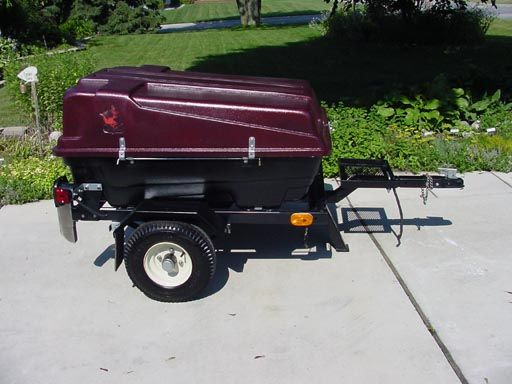 The Trailer Consists Of A Cargo Carrier Mounted To A Metal Frame