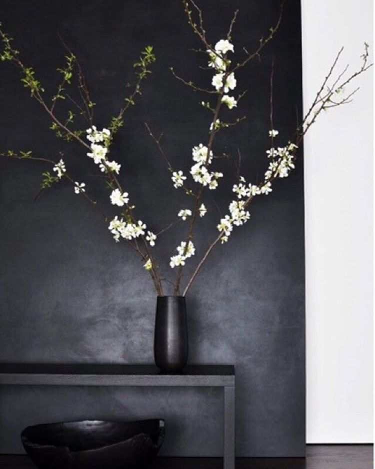 """These delicate blooming branches and that matte black wall are incredible together. Softness meets modern."""