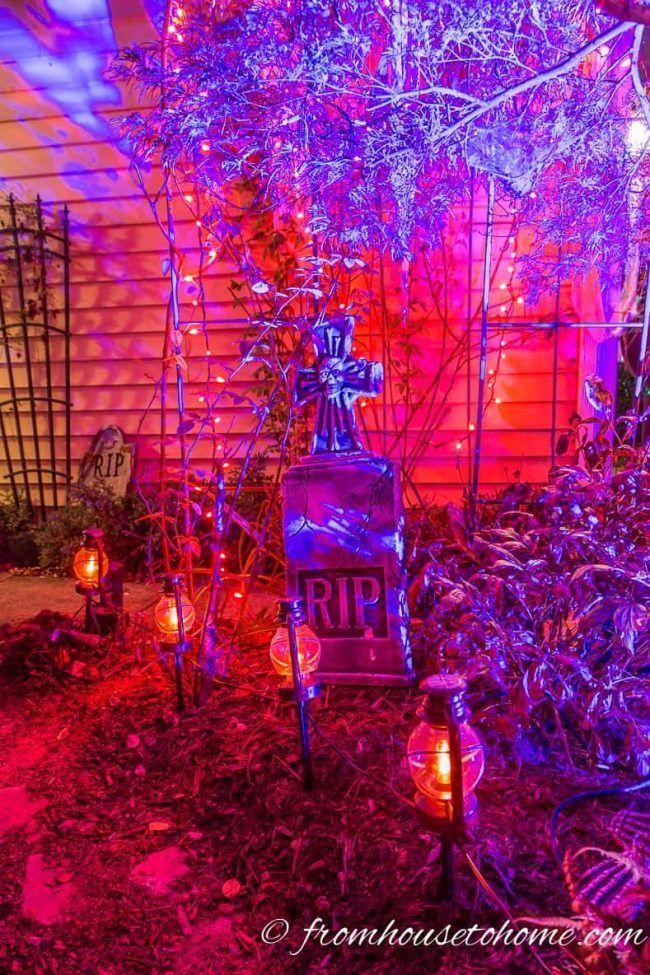 Awesome Halloween yard decor! I love the purple and orange lights on the Halloween tombstone.   Yard Haunt