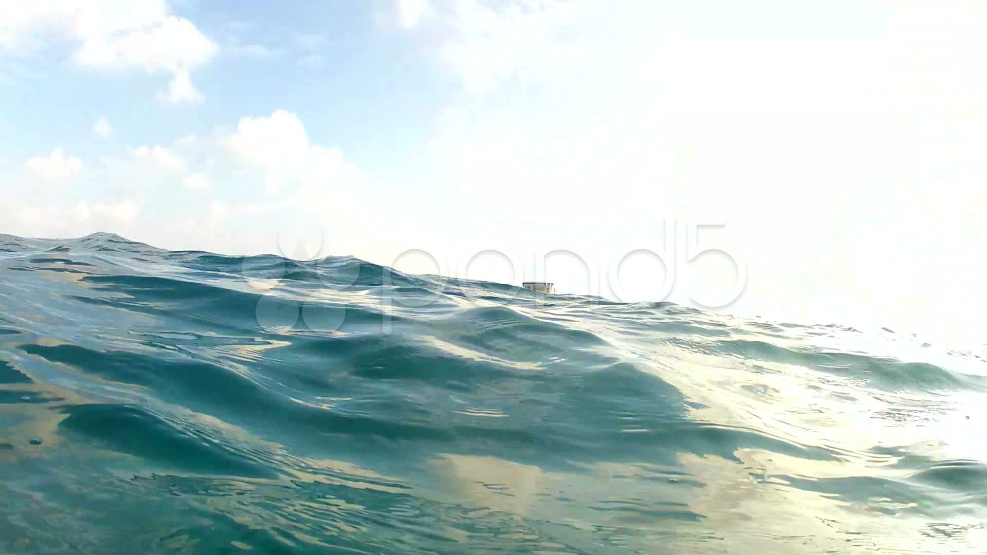 Diver Breaking Surface Of Ocean To See Boat Approaching Stock Footage Surface Ocean Diver Breaking Ocean Boat Diver