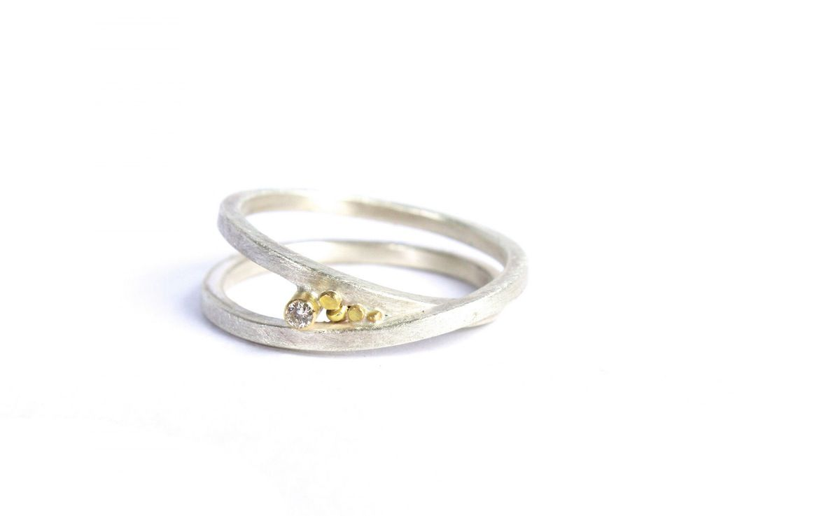 The Speckle Infinity Ring is made of sterling silver with 18ct Yellow Gold. With a 0.08ct White Diamond set in 18ct Gold this ring is perfect for...