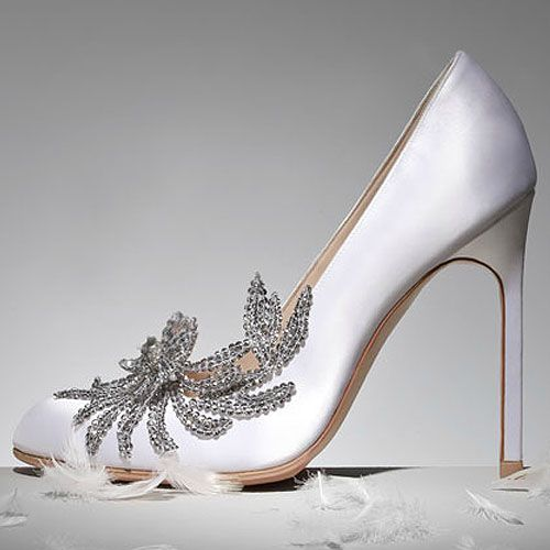 Bella Swan S Wedding Shoes The Manolo Blahnik Swan Satin Pumps Are Now Available At Neiman M Manolo Blahnik Manolo Blahnik Heels Manolo Blahnik Wedding Shoes