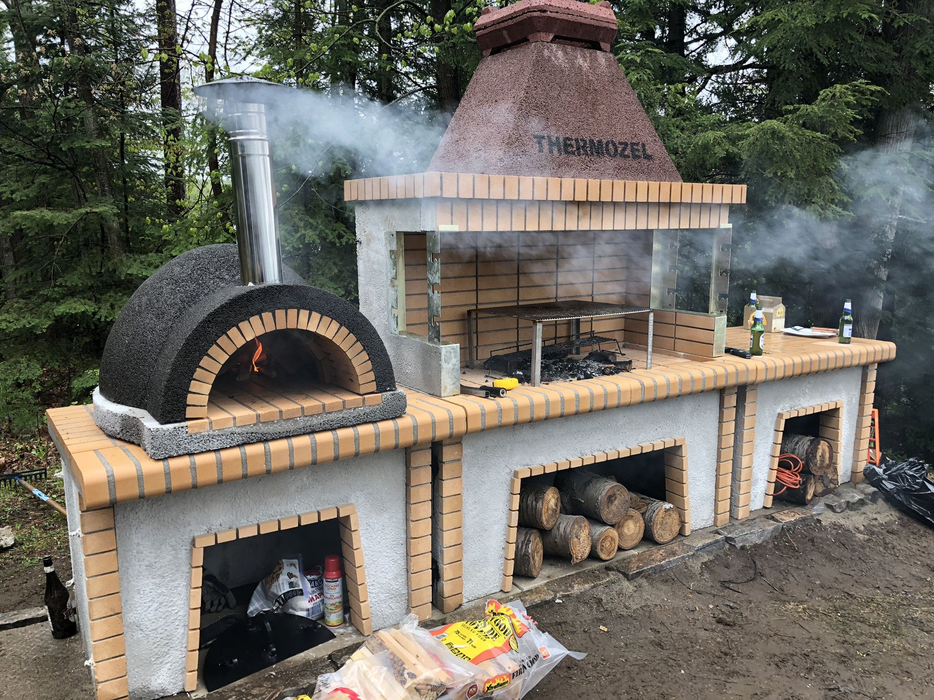 Photo of Firebrick outdoor kitchen with large pizza oven with Stone – ROTISSERIE BBQS