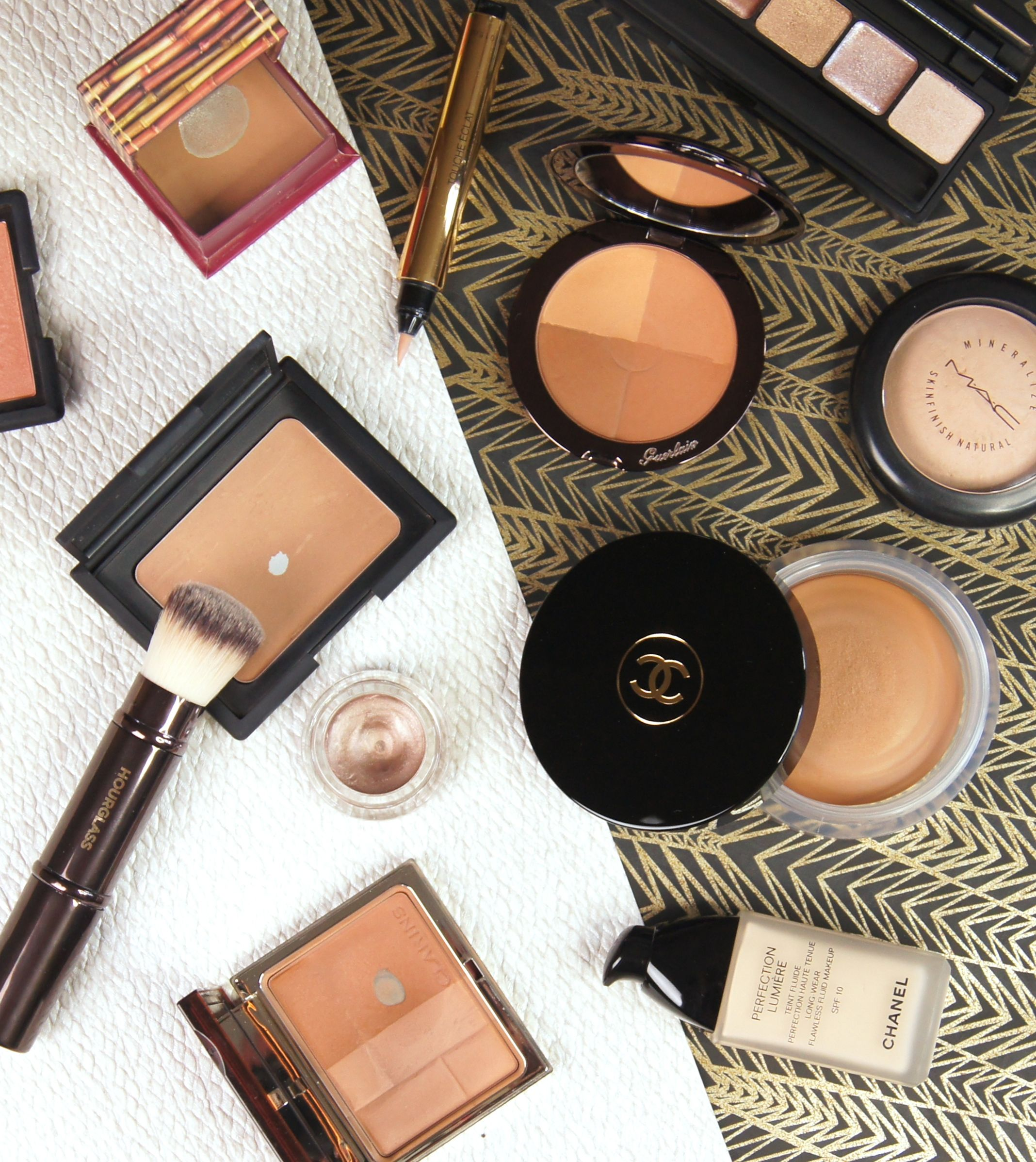 The best bronzers for a gorgeous, golden glow, featuring Benefit Hoola, Chanel Soleil Tan De Chanel, Clarins Bronzing Duo, Nars Laguna and Guerlain Terracotta 4 Seasons.