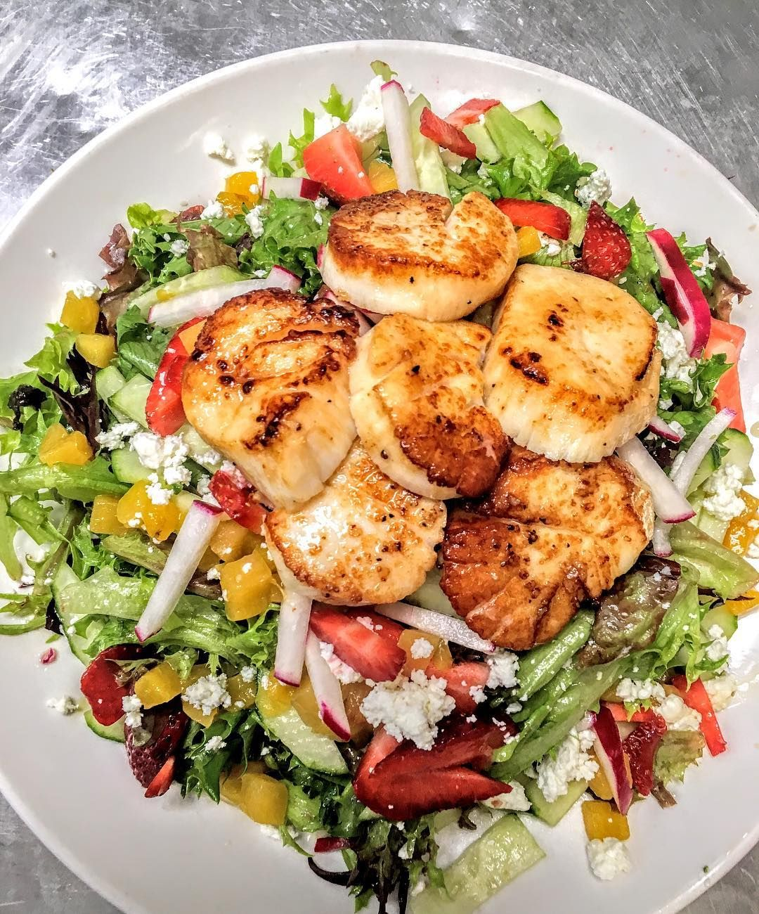 Summer Salad🥗  Mixed Crispy Greens fresh strawberries🍓 ,peaches🍑 , cucumber🥒 ,radish ,  goat cheese crumbles tossed in a lemon basil vinaigrette topped with pan seared StoningtonCT Sea Scallops