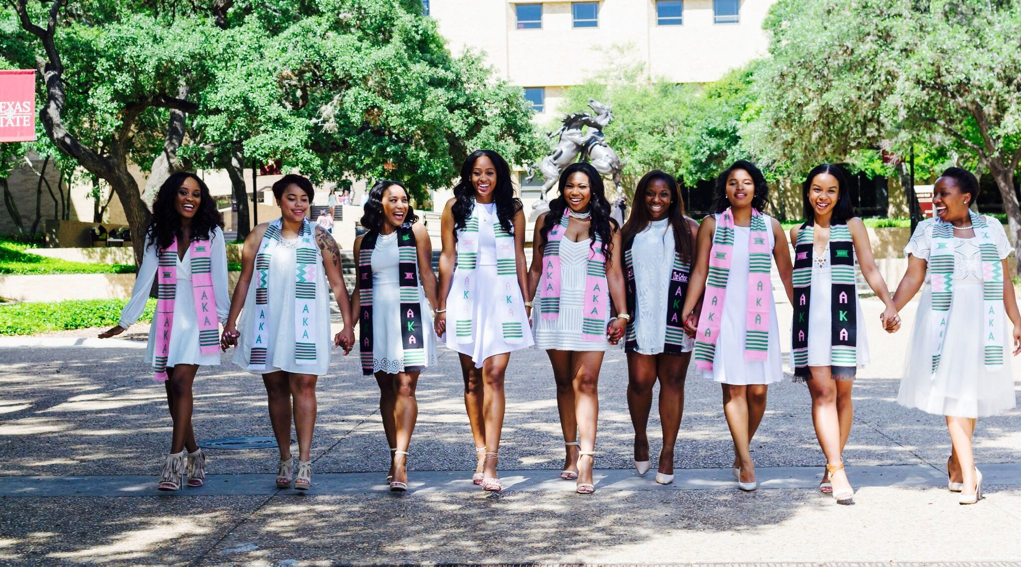 Texas State University  Alpha Kappa Alpha Sorority Incorporated Graduates Group Picture Ideas #TXST #Graduates #Graduation #GroupPictureIdeas #AlphaKappaAlpha #Sorority #BlackGirlsRock #SuccessfulWomen #PrettyinPink #Happy #Laughing #GradPics