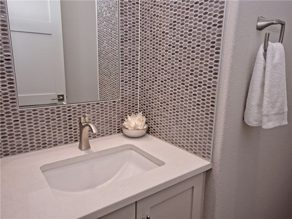powder bathroom glam mosaic tile was installed outlined with schluter schiene metal edge profile before