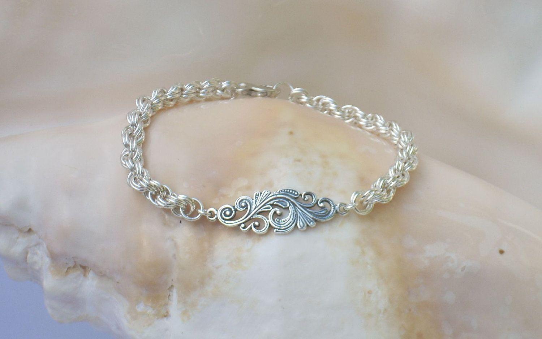 Sterling filigree link on an argentium silver double spiral bracelet
