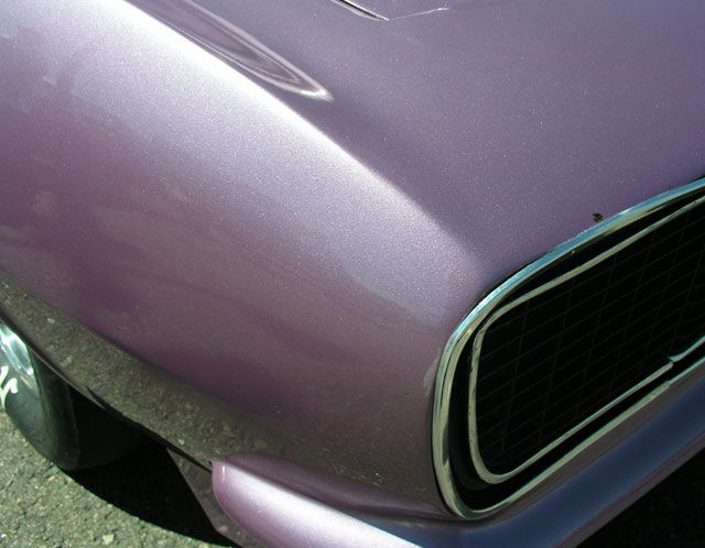 light purple car paint candy painted over a dark base coat for